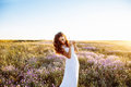 Young woman in wedding dress outdoors. beautiful bride in a field at sunset Royalty Free Stock Photo