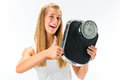 Young woman with weight scale Stock Photography