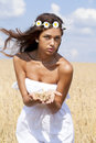 Young woman in a wheat golden field Royalty Free Stock Photo