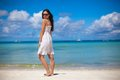 Young woman in white dress enjoy the beach vacation this image has attached release Royalty Free Stock Images