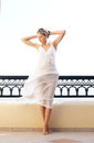 A young woman in a white dress on a resort background Royalty Free Stock Photography