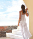 A young woman in a white dress on a resort background and attractive brunette caucasian posing the image is taken beautiful Royalty Free Stock Images
