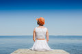 Young woman in white dress sunbathing at the seaside Royalty Free Stock Photo