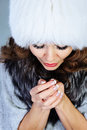Young woman in white fur hat Stock Photos