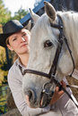 Young woman with a white horse Stock Photography