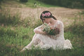 Young woman in white lacy on meadow Royalty Free Stock Photo