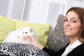 Young woman and a white Persian cat in the house Royalty Free Stock Photo