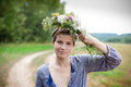 Young woman with wild flowers in summer day Royalty Free Stock Photo