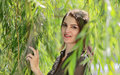 Young woman in a willow portrait of beautiful among leaves of Stock Images