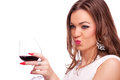 Young woman with wine sending kiss Photos stock