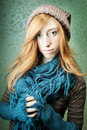 Young woman in winter clothes beautiful red haired model with woven hat and blue scarf Royalty Free Stock Photo