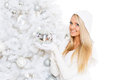 Young woman in winter clothes christmas happy beautiful with mirror ball stands near tree on a white background Royalty Free Stock Photos