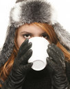 Young woman in winter dress drinking coffee or tea Royalty Free Stock Image