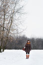 Young woman in winter park beautiful walking Royalty Free Stock Photos