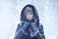 Young woman winter portrait with falling snow Stock Photo