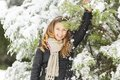 Young woman at winter with trees under the snow Royalty Free Stock Images