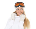 Young woman  in winter warm clothes and ski glasses. Royalty Free Stock Photo