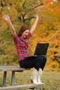 Young Woman wirh laptop computer celebrating Stock Photography