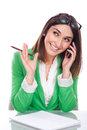 Young woman at work smiling to your mobile beautiful Royalty Free Stock Photo