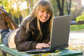 Young woman working with laptop in city park Royalty Free Stock Photo