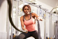 Young woman working out with battle ropes at a gym Royalty Free Stock Photo
