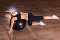 Young Woman Working Out with Exercise Ball Royalty Free Stock Photo