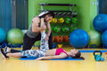 Young woman working out with personal trainer at the gym. Royalty Free Stock Photo