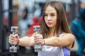 Young woman working out with two dumbbells Royalty Free Stock Photo