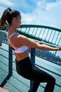 Young woman workout  outdoor in the city promenade by the river Royalty Free Stock Photo