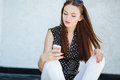 Young woman writes an sms to your mobile phone Stockfotografie