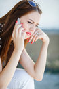Young woman writes an SMS to your mobile phone Royalty Free Stock Photo