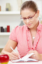 Young woman writing diary Royalty Free Stock Images