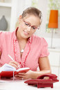 Young woman writing diary Stock Photography