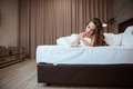 Young woman writing notes lying on the bed Royalty Free Stock Photo