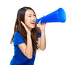 Young woman yell with megaphone isolated on white Royalty Free Stock Photo