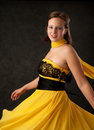Young woman in a yellow dress Royalty Free Stock Photography