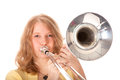 Young woman in yellow mini dress playing the trombone against white background Stock Images