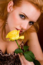Young woman with yellow rose Royalty Free Stock Photo