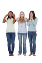 Young women acting out three wise monkeys on white background Royalty Free Stock Image
