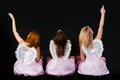 Young women as angel three beautiful wearing s wings back view Royalty Free Stock Photography