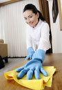 Young women badroom cleaning Stock Image