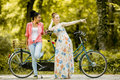 Young women by the bicycle Royalty Free Stock Photo
