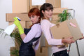 Young women cleaning Royalty Free Stock Photo