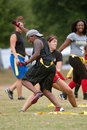 Young Women Collide Practicing Flag Football Royalty Free Stock Images