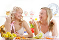 Young women cooking salad Stock Photo