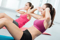 Young women doing abs workout at the gym Royalty Free Stock Photo
