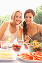 Young women eating outdoors Stock Image