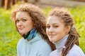 Young women on field in summer Royalty Free Stock Photo