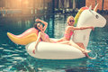 Young women friends in the swimming pool fun Royalty Free Stock Photo