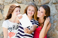Young women girlfriends and tablet pc computer three girl friends with different hair happy laughing at blogging message Royalty Free Stock Photo